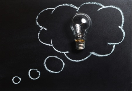 drawing on chalkboard of a lightbulb